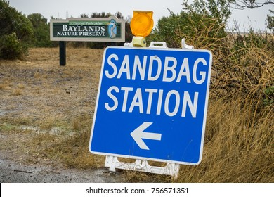 Sandbag Station sign on a rainy day when there is a risk of flooding; Palo Alto, San Francisco bay area, California
