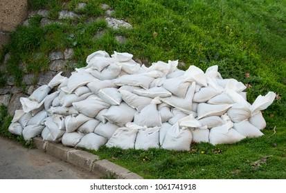 Sandbags for flood control on grass