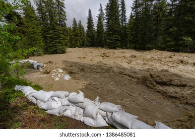 sandbags protection from raging river, first line of sandbags br