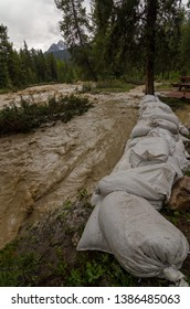 sandbags protection from raging river, sandbags holding up