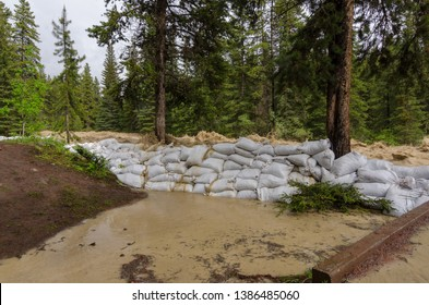 sandbags protection from raging river , but will fail and fall
