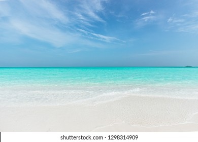 Sandbank in Maldives with crystal clear beautiful water and white sand.