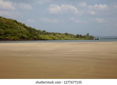 Sandbank on river in Goa