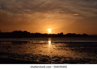 Sandbanks beach at sunset, Dorset, England