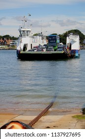 Sandbanks, Dorset, England - June 02 2018: Cars and a bus on board the Sandbanks Chain Ferry which crosses the entrance of Poole Harbour, showing the chain which propels it using a diesel engine