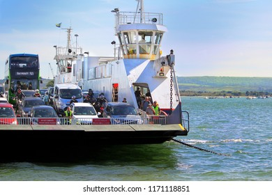 Sandbanks, Dorset, England - June 02 2018: Cars and a bus on board the Sandbanks Chain Ferry which crosses the entrance of Poole Harbour