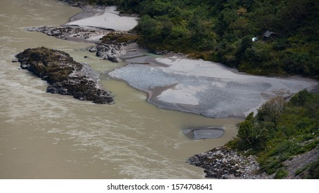 A sandbar formed by sediment deposits at the bend of a river