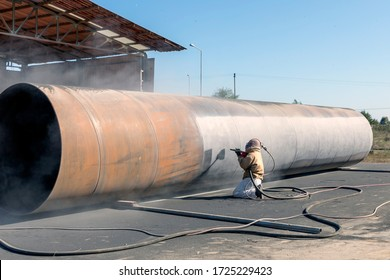 Sandblasting or abrasive blasting with grit. Sandblasting is used for cleaning industrial as well as commercial structures, but is rarely used for non-metallic workpieces.