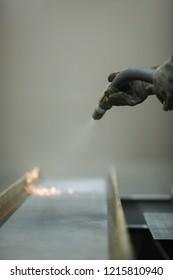 Sandblasting. Worker holds a tool. Sandblast. Blast it!