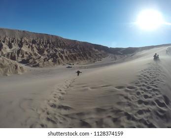 Sandboard in Valle de la Muerte. San Pedro de Atacama. Chile