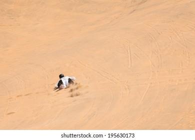 Sandboarding fun in Namibia, Africa