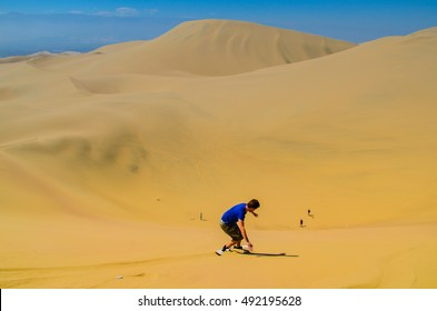 Sand-boarding fun on Atacama Desert, Oasis of Huacachina, Ica Region, Peru