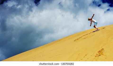 sandboarding kid