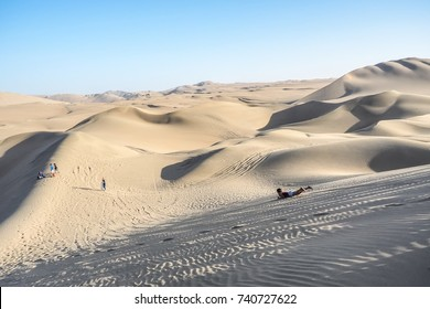 Sandboarding, the most famous activity in Huacachina, Peru.