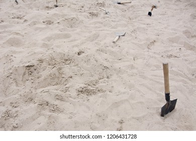 sandbox for adults, sandbox with shovels, thrown shovels in the sand