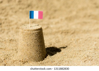 Sandcastle with the national flag of France