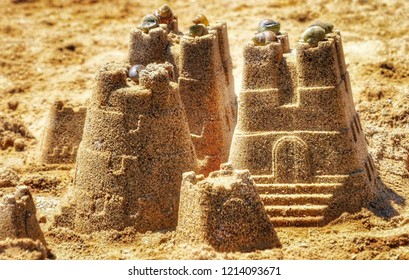 Sandcastle on the beach with shells