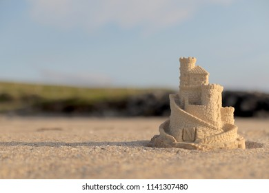 Sandcastle on sand beach with short depth of field
