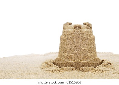 a sandcastle on the sand on a white background
