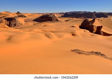 Sanddunes and rock towers at Moul Naga, Tadrart, Tassili n´ Ajjer National Park, , Algeria, Sahara desert, North Africa