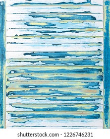Sanded abstract paint grunge background in yellow, blue, pink, green and antique black on a louvered, textured wood panel vertical