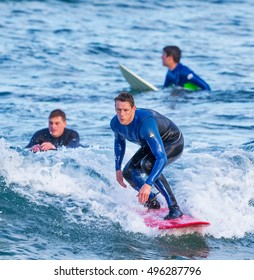 SANDEND, MORAY, SCOTLAND - 8 OCTOBER 2016: This is surfing at the beach of Sandend, Moray, Scotland on a sunny 8 October 2016.