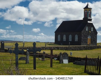 Sandgerdi, Hvalnes / Iceland - 04/29/2018 - Hvalsneskirkja Icelandic Church and Cemetery. This church and adjacent graveyard date back to 1887.
