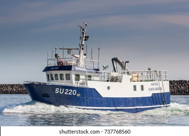 Sandgerdi, Iceland - May 16, 2012 : Commercial fishing boat 2400 Hafdis SU-220 arriving to port in Sandgerdi, Iceland.