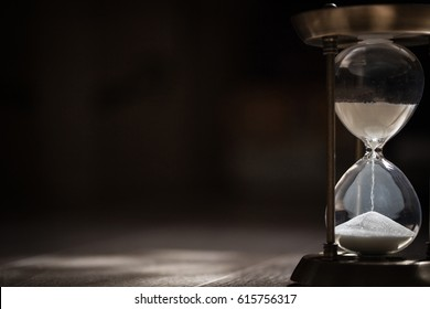 Sandglass, hourglass or egg timer with shadow showing the last second or last minute or time out. With copy space.