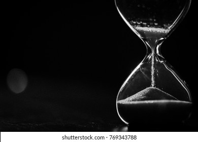 A sandglass, modern hourglass or egg timer showing the last second or last minute or time out. With copy space.