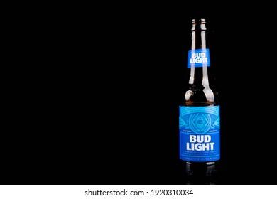 Sandhurst, United Kingdom; February 16th 2021:- An open bottle of Bud Light isolated on a black background