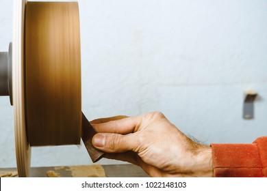 sanding wood on a lathe