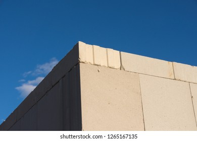 Sand-lime brick wall corner in front of blue sky