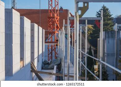 Sand-lime brickwork alongside scaffolding in the morning sun