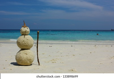 Sandman with blue sea background