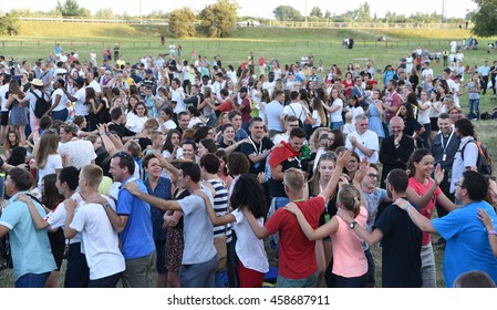 SANDOMIERZ, POLAND - JUL 23, 2016: World Youth Day 2016. Pilgrims dancing and playing games. WYD is internationally event for young people.