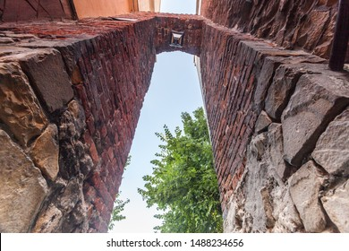 SANDOMIERZ, POLAND-SEPTEMBER 23, 2019: Sandomierz one of the oldest towns in Poland. Dominican wicket, gate called Eye of the needle Ucho Igielne