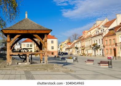 SANDOMIERZ, SWIETOKRZYSKIE PROVINCE/POLAND - OCTOBER 26, 2016: Vintage well on Old Marketplace near town hall.