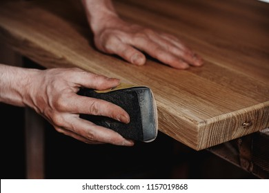 Sandpaper sanding. Sanding wood with sandpaper. Tools joiner