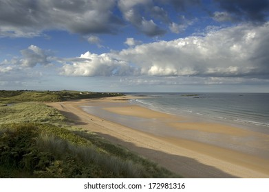 The sands of Embleton bay in late afternoon sunlight