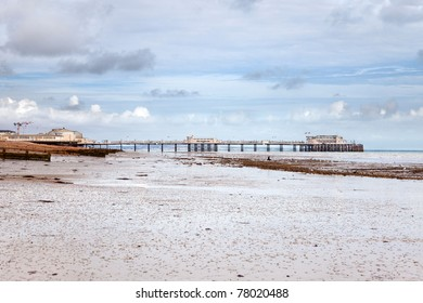 Sands at low tide by Worthing's Victorian pier