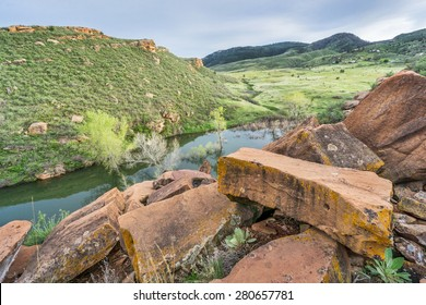 sandstone blocks on the old quarry on a shore of Horsetooth Reservoir with a view of mountain valley in Lory State Park, Fort Collins, Colorado