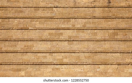 Sandstone brick wall with lines texture background