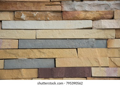 Sandstone bricks seamless of house wall texture background.