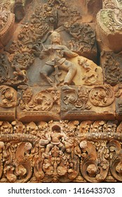 Sandstone carving at the wall of the ancient Banteay Srei Temple ruin in Siem Reap, Cambodia.