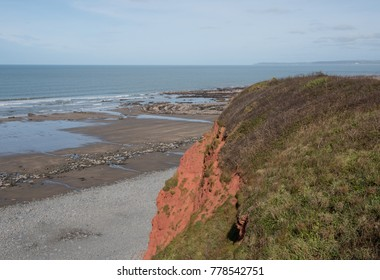 Sandstone Cliffs of Peppercombe Beach with the Atlantic Ocean in the Background on the South West Coast Path between Westwood Ho and Clovelly in Rural Devon, England, UK