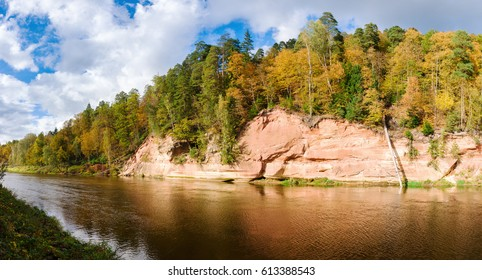 Sandstone cliffs Velnala by the river in Gauja national park in Latvia