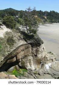 Sandstone cliffs and wide sandy beach along the Oregon coast