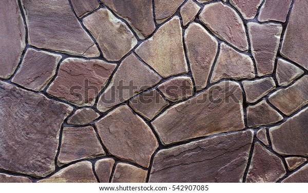 sandstone facing stone, decorative Stonewall texture close-up