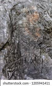 sandstone rock with scratched engraving graffit portrait